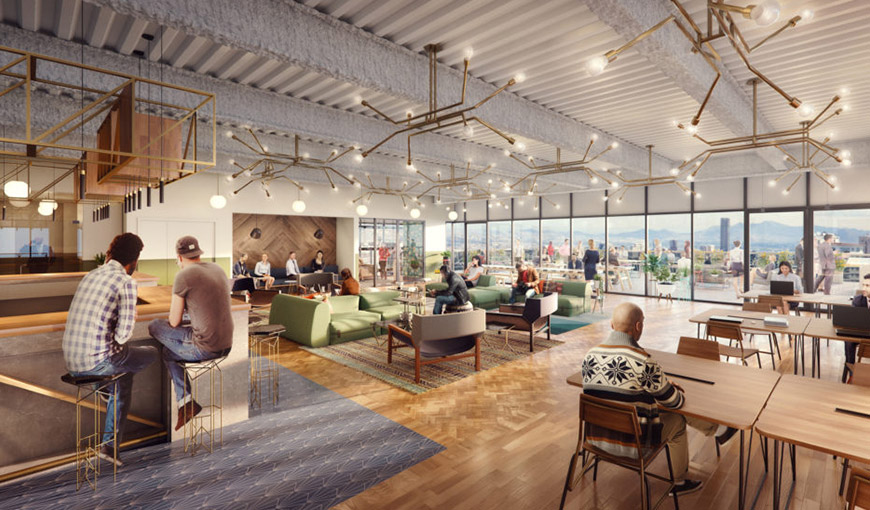A modern coworking space with multiple people sitting at desks, couches and a bar - Absolunet eCommerce Trends